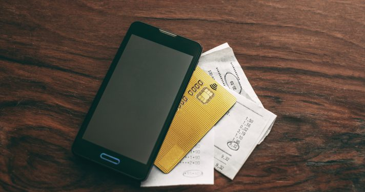 Mobile phone with credit card and receipts