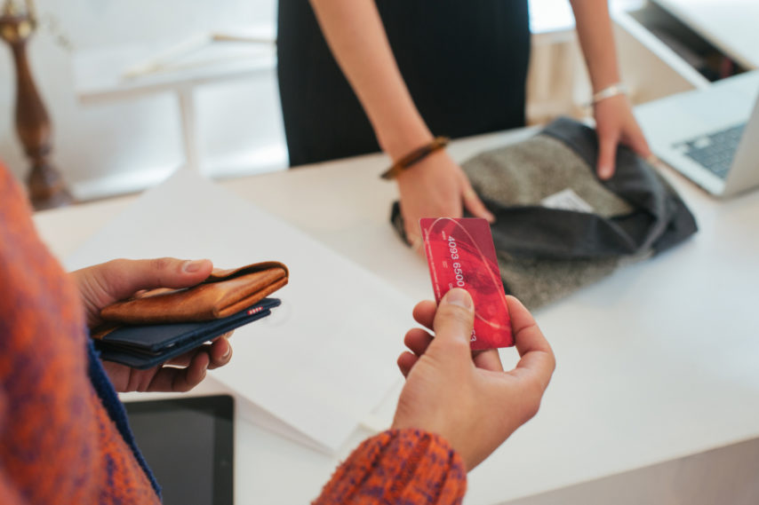 Shopping - Close Up of Male Customer Paying With Credit Card in